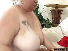 Fat woman sitting on her knees sucking dick