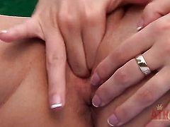 Blonde Nataly Von gives a closeup of her cunt as she masturbates