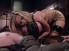 Three words cross my mind when it comes to describe naughty Madeline: a real player. This versed mistress loves wearing kinky outfits and torturing horny guys seems her specialty. The seducing blonde-haired bitch has mouth gagged her slave and can enjoy the taste of his cock, as she pleases. Watch details!