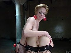 A short-haired lesbian gets really turned on, especially after her gorgeous partner rims her ass with a lusty desire. Anal insertion is also involved in this dirty game. The atmosphere gets even hotter, when the busty blonde with red earrings begins to slap Gabriella's buttocks. Don't miss the kinky scene!