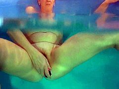 Dirty-minded light haired mature nympho Jitka masturbates in the pool