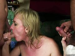 Blonde Monik with massive boobs has fire in her eyes as she gets her throat banged by her bang buddy
