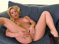 Fully nude well stacked blonde babe Cherie Deville plays with her nice pink pussy with legs wide open for your viewing pleasure. She touches her hairless spot over and over again.