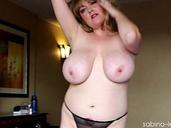 Sabina Leigh shows her enormous natural tits and gives a blowjob