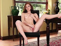 Natalie Lust with tiny tits and hairless cunt fucking herself like crazy in solo scene