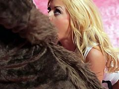 Long haired charming blonde Riley Steele teases Axel Braun with her lovely boobs. He pulls out his fat dick and fucks her mouth without taking off his costume. She loves to blow!