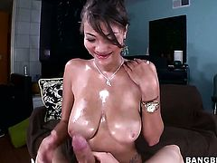 Huge tits get oiled up and fucked