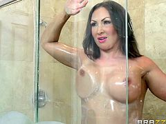 Are you interested in horny milfs, who are just ready to give in to a hard dick? A lusty guy finds Yasmin in the kitchen, showing off her crazy tits. The atmosphere gets really wild, as they head to the shower, where they can play dirty. Don't miss the exciting details!