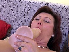 If you are fond of mature ladies, click to watch a naughty woman playing kinky with her lusty pussy, which she generously exposes in front of the camera, along with her huge tits. Click to watch Jana sucking her nipples with a passionate desire. Fingering her cunt is also part of the game. See her use a dildo.