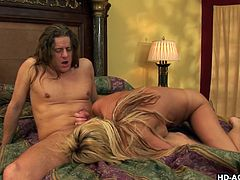 Super hot blonde with a juicy hot ass rides the dick. As she rides him the dude almost rips her ass as he mashes it like any dude wold. She then sucks his wood hard.