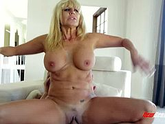 Jaw dropping hungry blonde MILF Tara Holiday rides Billy Glide's prick