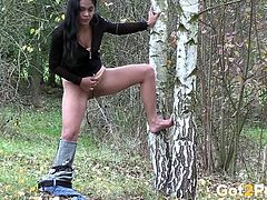 Raven haired dumpy harlot pissed on the birch in the forest