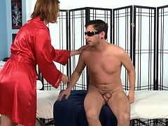 Fair haired sexy chick in red night dress is gonna give steamy massage to her man