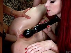 Penny's sensual cunt is the center of attention, as her two hot lesbian friends are eager to find satisfaction in the most kinkiest ways. See the blonde-haired bitch spreading legs widely and getting her lovely ass penetrated with a strap on. To spice up the atmosphere, the redhead slut brought a vibrator.
