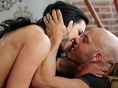 Jayden Jaymes is a sexy bodied flirtatious brunette beauty who is proud of her perfect huge tits. She poses topless in front of hot bald guy to turn him on. Her hooters drive him crazy!