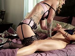 If you love tattooed women, click to see two horny lesbians dressed in a provocative way with high heels, sexy stockings and lingerie. The blonde-haired slut explores her companion's hot body with a lusty desire. Pussy eating and face sitting are part of the kinky game they like to play...