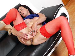 A Czech cougar in red stockings is more than ready to play with her horny pussy in front of the camera. Watch her installing on the comfortable couch, surrendering herself to the fever of lusty desires... The naughty mature bitch loves using kinky sex toys, such as a dildo.