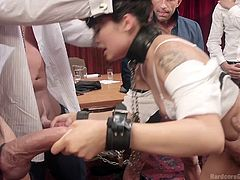 A stunning brunette lady has been captured by some angry guys, who put her in chains and make her wear a kinky collar at her neck. Click to watch sexy Milcah completely naked, while mouth fucked and sucking dicks on knees. She's about to get banged hard, so enjoy every moment!