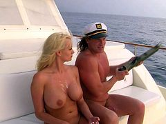 Big racked blond-haired MILF Stormy Daniels loses her bikini to make captain happy during their hot sea trip. She gets her snatch licked and fucked on a boat under the open sky.