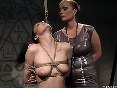 Mature Katy Parker with massive jugs demonstrates her body parts as she gets tongue fucked by lesbian Carrmen