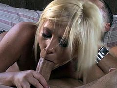 Topless busty blonde Tasha Reign in tight blue jean shorts shows her love for cock sucking in bed with a lucky dude. She sucks his sausage like crazy and then rides it cowgirl style!
