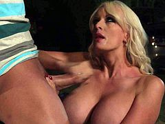 Gorgeous MILF Stormy Daniels with long blonde hair and big breasts gets her pink pussy stuffed outdoors beside a car. Watch big racked woman in stocking get shagged on the ground.
