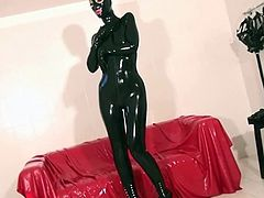 Black rubberdoll wanking