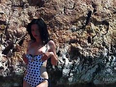 The air is filled with eroticism. The sea breeze plays with this sensual slut's hair, while clear waves splash her crazy body. The sensual brunette gets really horny and takes off her sexy swim suit, exposing her shaved peachy pussy. See naughty Yasmi fingering herself!