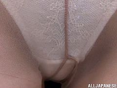 These two men tear open her blouse, to reveal her amazing boobs, and then they lift up her skirt, to get a look at her hairy pussy. The sexy slut has a tiny vibrator used on her cunt and clit. The men want to see their coworker orgasm.