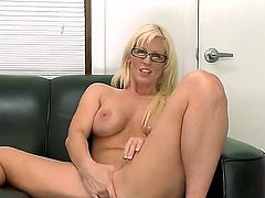 Here, we have a blonde young milf that spread her legs on the couch! Shes going to finger that moisty and horny fanny of hers till she cums quite a lot and real hard, too