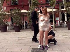 These sluts have been naughty, so their master is going to punish them on the street. The girls are wrapped tightly together in plastic wrap and walked through the town square, where everyone can see them.