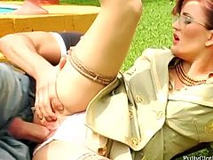 Full clothed outdoors orgy featuring two oversexed bitches in glasses