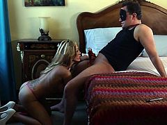 Riley is feeling horny, so she gets on cam and spreads her pussy lips, so the viewers at home can get a nice look and jack off. In the next scene a hot blonde Canadian slut sucks on her masked man's cock.