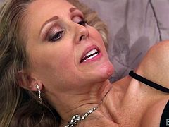 Slutty Julia has been gagged and her hands were tied, so when a naughty brown-hair lady enters the bedroom, she finds her totally helpless. Click to see Chrissy, kissing the busty blonde milf and undressing.