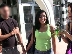 The smiling lady walking with her lover down the street, finds funny the idea of showing her tits for an instant. The courageour uninhibited brunette, who agrees to get challenged, is eager to take off her pink pants and show her lovely pussy to the camera, while wearing a shiny tiara!
