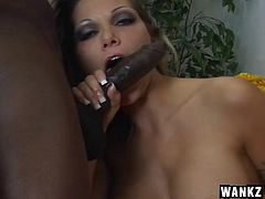 Stocking-clad blonde whore with nice juggs sucking a huge black cock