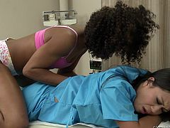 This black beauty rubs her hands all over the sexy body of her cute Asian nurse girlfriend. She pulls off her clothers and touches that beautiful ass, before kissing those luscious lips, and licking those perky nipples.