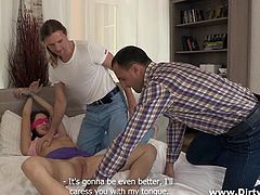 Adel's boyfriend Roman, has an idea to tape her hands together and blindfold her. He then beckons the guy, who comes in the room, to get there and start licking her pussy. She enjoys it, having no idea what's going on. The guy gets undressed and ready to fuck her.