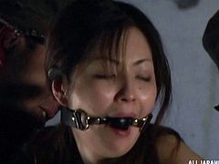 Tied up and gagged Asian girl used by horny guys