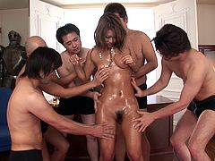 Greasy Asian cowgirl has her pussy stroked with a toy in a wild groupsex shoot