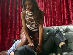 All that the horny man relaxing on the couch has to do, is to listen to his partner, a naughty ebony shemale, who is just craving to play dirty tonight. Watch slutty Natassia, seducing the guy with her dominating and in the same time, provocative attitude. See the bitch's ass rimmed, as she sucks dick...