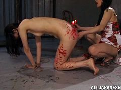 This cute slave is in so much pain, as the mistress pours hot candle wax all over the beauty's smooth skin. The mistress gives her slave some pleasure, too. Watch as she gets her wet cunt fingered vigourously.
