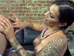An attractive and dominant shemale enjoys to play dirty with her horny partner, who's costumed in a fancy dress and wears high heels. The brunette foxy ladyboy with nice tattooes, just wants to taste his cock and fists his ass. Wait to see the exciting details!