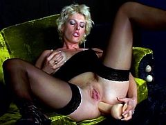 Blonde slut in stockings and lingerie loves to get ass fucked with big dildo
