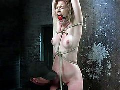 The punishement, which the merciless executor wants to apply to his slutty slave, is more rough than Ella has ever imagined. Click to watch the naked blonde bitch tied up strongly with ropes, while her cunt is aroused with a kinky vibrator.