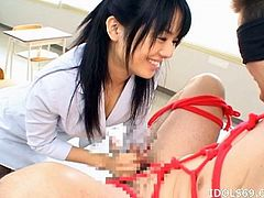 Japanese mistress ties up her man and jerks his cock