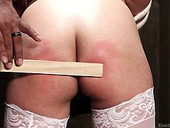 Darling Deicide helps with today's demonstration, which is using rope bondage and spanking. The instructor has Darling tied up and bent over, with her ass sticking out. She gets swatted with a ruler-shaped stick. Pay attention to learn, how to dominate your woman in a proper way.