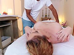 The horny masseur's hands are like magic and helps the blonde milf to relax. The naked busty bitch gets really aroused, especially when she notices that the guy's dick is getting harder, as he keeps massaging her back with oil. See the naughty slut sucking cock!
