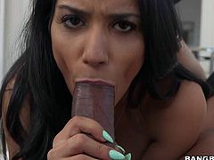 Dark haired sexy Tia Cyrus is naked and enjoys meaty black cock in her mouth. She rubs his thick sausage with her warm hands and gives head at the same time. Watch Tia Cyrus give interracial blowjob