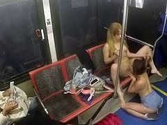 Shameless girls Ashley Adams and Camille Lixx both with long legs and juicy boobs strip naked to have lesbian sex in public. They tongue fuck each others shaved snatches on a train.